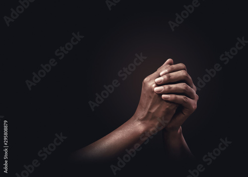 Valokuva Praying hands with faith in religion and belief in God on dark background