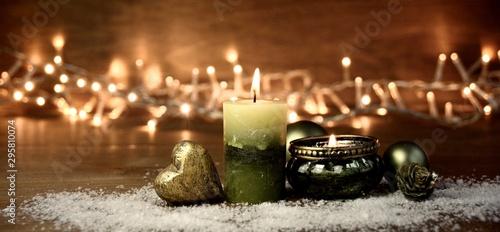 Photo  Weihnachten Hintergrund Panorama mit grüner Kerze und Teelicht