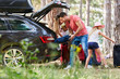 Leinwandbild Motiv Family at the car while loading with luggage