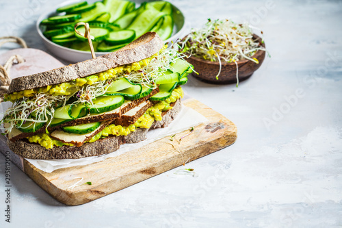 Big veggie sandwich with tofu, vegetables, sprouts and guacamole, copy space Canvas-taulu