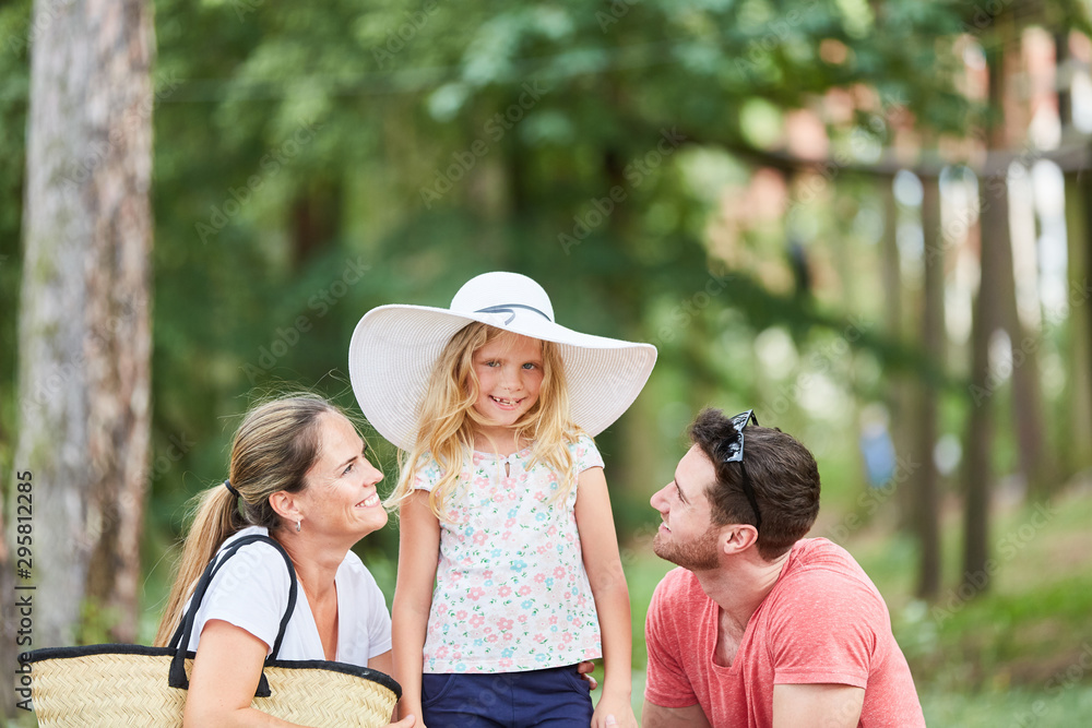 Fototapety, obrazy: Parents couple and girl in a big hat