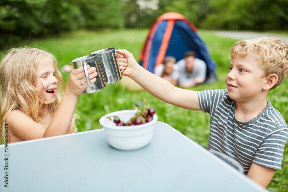 Fototapety, obrazy: Two children camping in nature