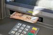 Euros withdrawal from an ATM machine, closeup view