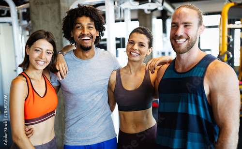 Group of young people doing exercises in gym Wallpaper Mural