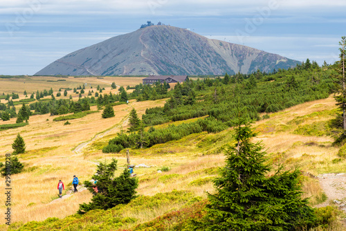 Fototapeta View of hiking trails and Karkonosze (Krkonose) mountains national park at the Poland and Czech Republic border. Scenic summer landscape with beautiful views. Lucni Bouda hotel in the foreground obraz