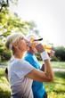 Leinwanddruck Bild - Mature or senior couple doing sport outdoors, jogging in a park