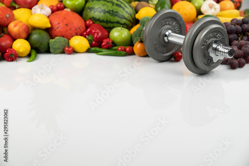 Fitness concept – healthy nutrition and equipment for fitness exercises on the white background Wallpaper Mural