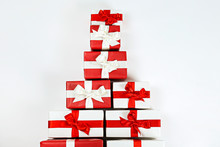 Bunch Of Christmas Presents Stacked In A Shape Of Pine Tree, Tied With Shiny Silk Bow. Multiple New Years Gifts In Different Wrapping. Top View, Close Up, Copy Space, Background, Flat Lay