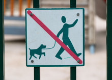 No Dog Walking Sign On The Gates Of A Childrens Playground