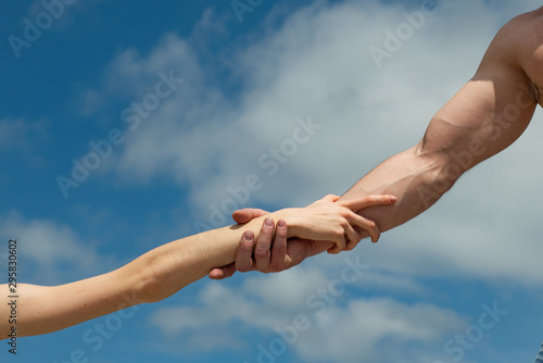 Hands. Female and male hand against the sky. Help and support. Together concept.
