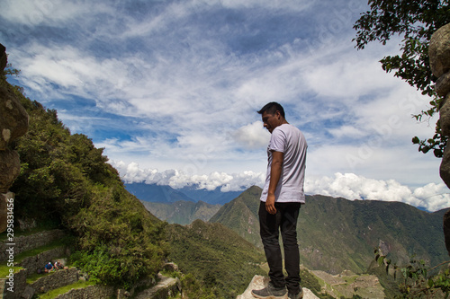 Fotografie, Obraz  Traveller at the Lost city of the Incas, Machu Picchu,Peru on top of the mountai