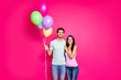 Leinwandbild Motiv Photo of charming guy and lady couple holding air balloons in hands came to parents birthday party wear casual outfit isolated pink color background