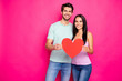 Leinwandbild Motiv Photo of amazing guy and lady hugging holding big paper heart in hands expressing positive attitude wear casual outfit isolated pink color background