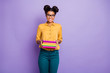Leinwanddruck Bild - Photo of amazing high school dark skin lady holding many colorful books diligent student wear specs yellow shirt trousers isolated purple color background