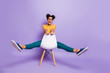 Leinwanddruck Bild - Full length photo of amazing dark skin lady sitting on chair between legs playful mood rejoicing wear specs yellow shirt trousers isolated purple color background