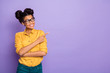 Leinwanddruck Bild - Photo of amazing dark skin lady indicating finger to empty space advising novelty interested looking side wear specs yellow shirt isolated purple color background