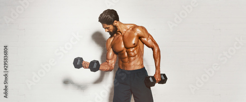Handsome Muscular Men, Bodybuilder Lifting Weights. copy space Tablou Canvas