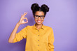 Leinwanddruck Bild - Photo of amazing pretty dark skin lady showing okey symbol best reliable worker diligent student wear specs yellow shirt isolated purple color background