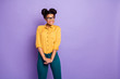 Leinwanddruck Bild - Photo of amazing pretty dark skin lady beaming smiling looking empty space interested wear specs yellow shirt pants isolated on purple color background