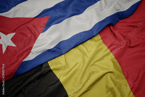 waving colorful flag of belgium and national flag of cuba. Canvas Print