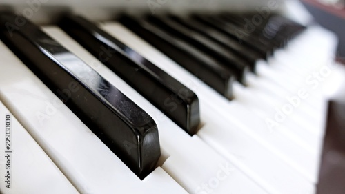 Piano, keyboard piano, side view of instrument musical tool. Background. - 295838030