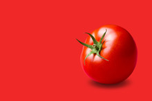 Red Tomato With A Green Stalk, On A Red Background, Concept