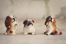 Doll, Three Dogs Made Of Ceramic On Wood Floors.