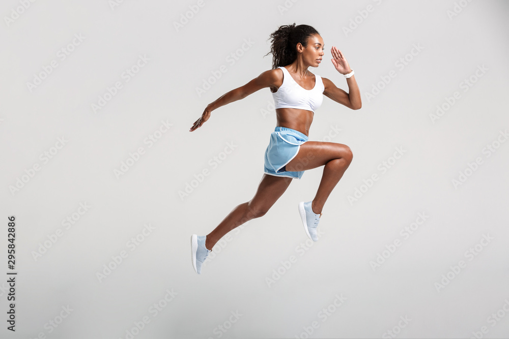 Fototapety, obrazy: Full length of an attractive healthy confident african sportswoman