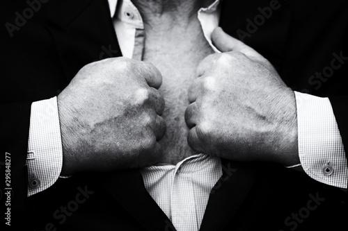 Senior man tearing a shirt and a suit on his chest showing hairy bare torso Tapéta, Fotótapéta