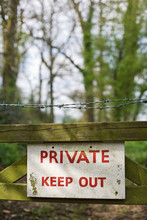 """""""Private Keep Out"""" Sign On A Gate In A Woodland."""