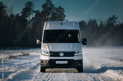 Fotografia, Obraz Volkswagen e-Crafter first electric cargo van ride fast at the snow field
