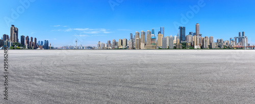 Fotografie, Obraz Wide race track ground and city financial district with buildings in Chongqing,China