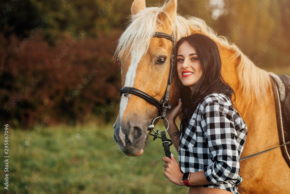 Fototapeta Young girl spending time with her horse
