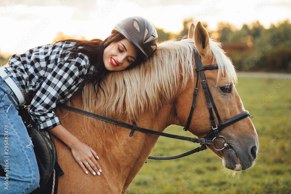 Fototapeta Beautiful young girl with her horse, autumn outdoors scene