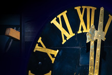 The Clock With Gilded Roman Numerals Shows Twelve Hours. The Midnight On Tower Clock. Clock Mechanism With Hammer And The Bells.