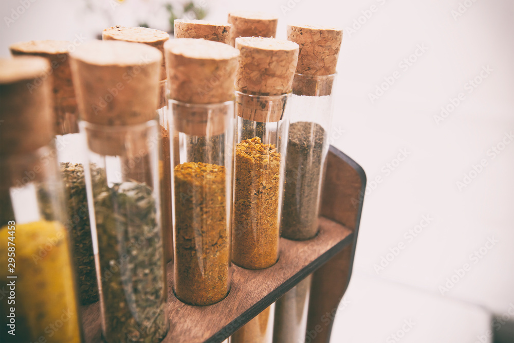 Fototapety, obrazy: Glass flasks with different type of spices on the kitchen table