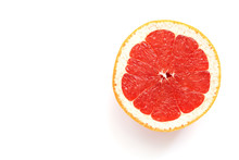 Half Of Juicy Pink Grapefruit On A White Background, Isolated. View From Above