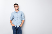 Photo Of Cheerful Funky Positive Intelligent Man Smiling Toothily Holding Hands In Pockets Isolated Over Grey Color Background