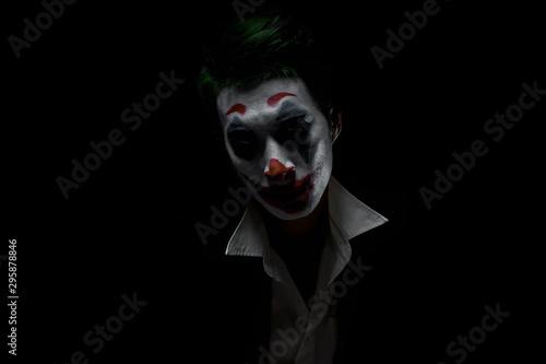 Photo  Makeup for Halloween: Image of a man in a joker makeup
