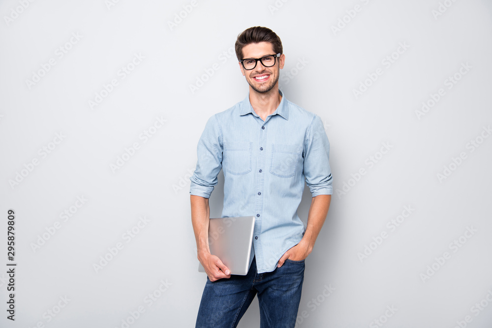 Fototapeta Photo of cheerful positive creative manager holding laptop with hands smiling toothily standing confidently showing his being successful isolated over grey color background