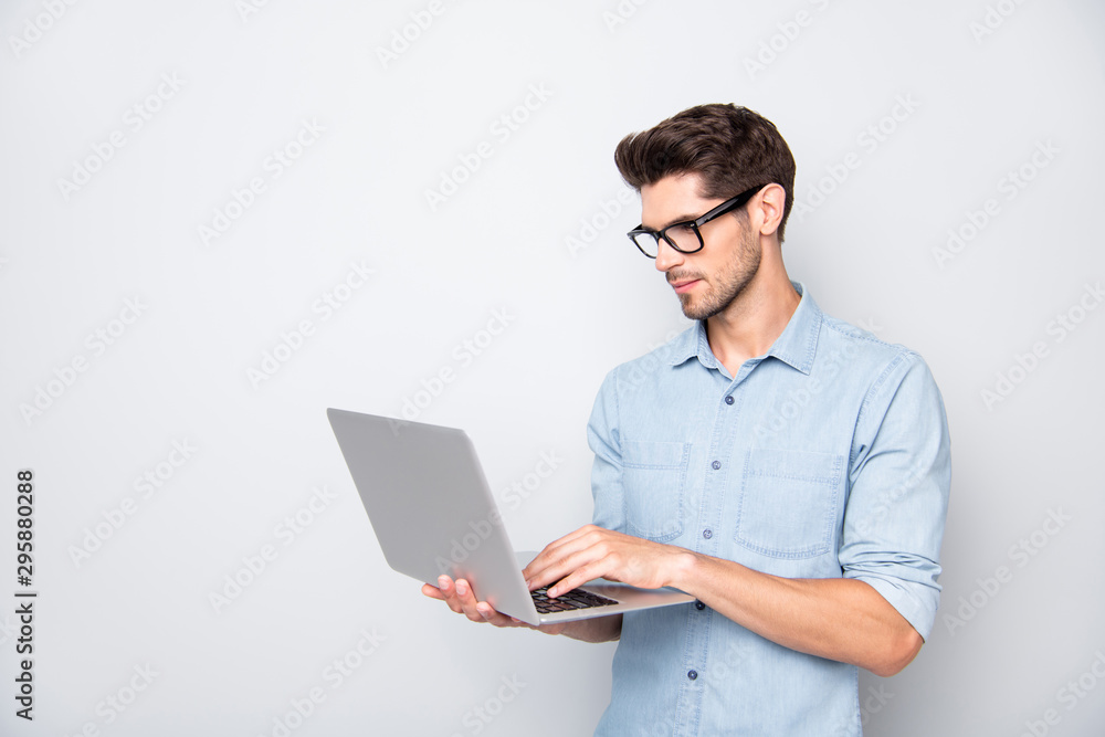 Fototapety, obrazy: Photo of thoughtful focused clever interested freelancer holding laptop with hands wearing eyeglasses working on deadline project isolated grey color background