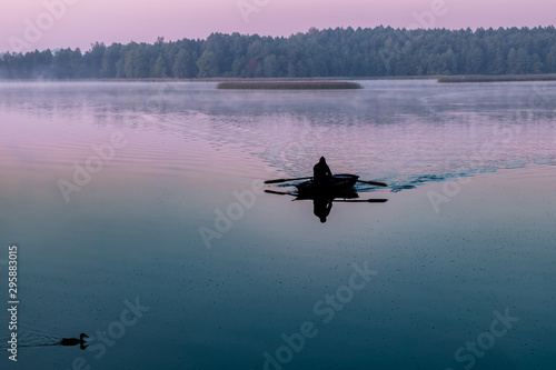 Montage in der Fensternische Blau türkis silhouette of man in a boat in the early morning. pink dawn with ducks