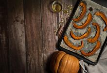 Slices Of Baked Pumpkin On Par...