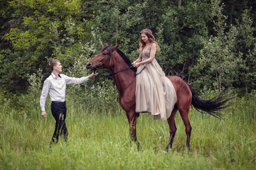 Love story. Two lovers in the forest. Photo with a horse