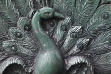 Closeup Of A Old Wooden Carving Of A Peacock