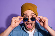 canvas print picture - Close up photo of cheerful excited funny rejoicing guy wearing cap headwear spectacles eyewear eyeglasses shouting omg in denim isolated over vivid violet color background