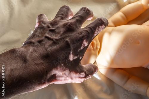 Fényképezés  child violence concept, man s hand over child s head