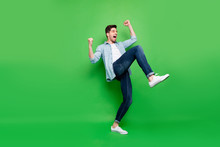 Full Length Body Size Turned Photo Of Cheerful Positive Excited Ecstatic Man Rejoicing With His Victory At Competitions Isolated Over Green Color Vivid Background