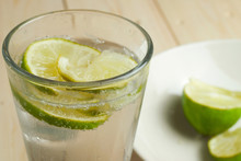 Refreshing Glass Of Fizzy Water With Lime Slices