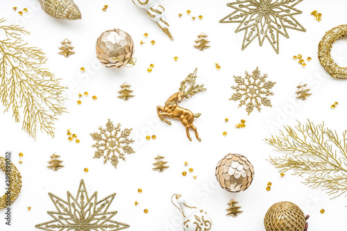 Gold christmas decoration on white background, flat lay, top view